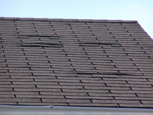 Roof displayed with worn curling shingles