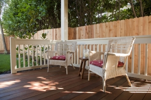 Patio furniture set on a deck in back yard.