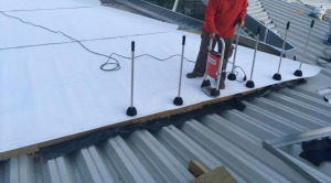 Why Choose a Commercial Roofer Who Uses the RhinoBond System?